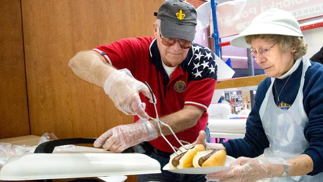 Ron McClelland, of American Legion Post 27, and Janet Litzenberg, of the Auxiliary, serve brats at the South Milwaukee Downtown Indoor Spring Market at South Milwaukee High School in 2016. This year's Spring Market is set for Sunday, March 18, at South Milwaukee High School.