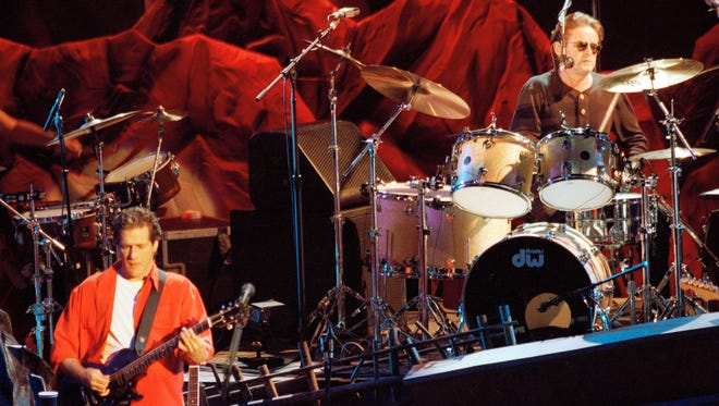 Glenn Frey and Don Henley, on drums, perform during an Eagles reunion concert on May 27, 1994, in Irvine, Calif.