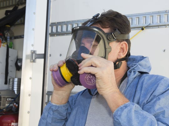 Dale Cillian, owner of Biohazard Cleanup Company uses chemicals to fog a Glendale residence believed to be contaminated with Methicillin-resistant Staphylococcus aureus, or MRSA, Wednesday, November 12th, 2014, in Glendale, Ariz. Cillian used a chemical that would also be used to clean areas contaminated with viruses such as Ebola.