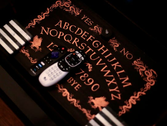 A Ouija board acts as a coffee table tray at the house of Laila Sixkiller and Christopher Baker.
