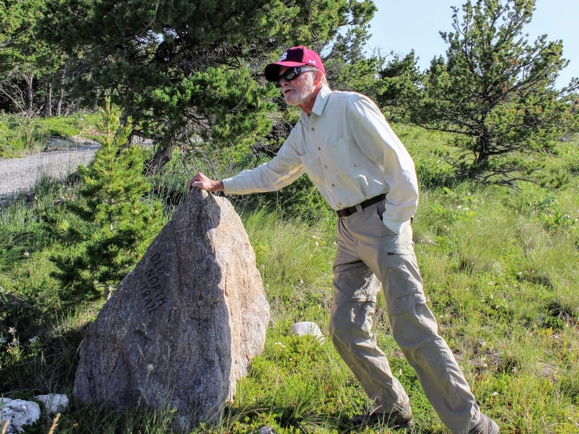 Dave Shea, Old Trail Museum board member and naturalist, stands with marker 13 on the Old North Trail. Local residents of Teton County got together in 1997 to place 23 of these stone markers along the Old North Trail to mark its location for years to come.