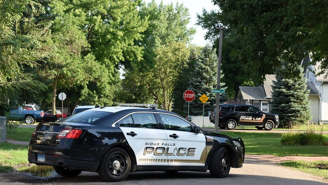 A police car blocks the road near the scene of a homicide Saturday in north Sioux Falls.