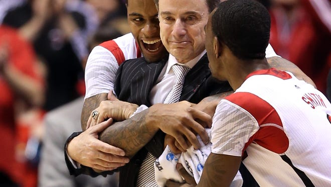 U of L's Chane Behanan, Rick Pitino and Russ Smith embrace after beating Duke in last year's Midwest Regional final at Lucas Oil Stadium.