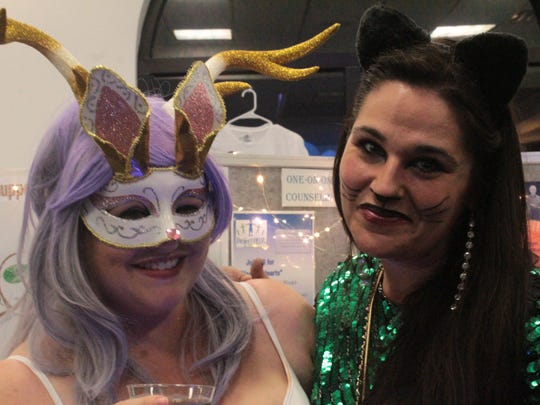 Laura Spiller, left, and Alexandra Frangie, right, are both board members of Project Help. Both ladies were some of the few guests to dress up in costumes for the event.