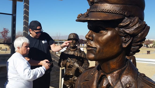 Karen Woods, left, president of the United Military Women of the SouthWest, directs artist Matt Glenn on Wednesday about where to place six statues of military women at a new memorial in Las Cruces Veterans Memorial Park, 2651 Roadrunner Parkway.