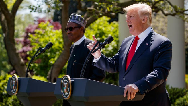 President Donald Trump speaks during a news conference with President Muhammadu Buhari in the Rose Garden of the White House.