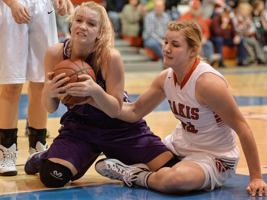 Albany's Rilei Larsen (51) rips the ball away from