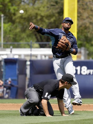 Tampa Bay Rays second baseman Alexi Casilla throws to first during a spring training game against the New York Yankees on March 9, 2015, in Tampa.