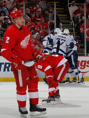 Brendan Smith (2) looks on with Justin Abdelkader as the Lightning celebrate their third power-play goal during Game 4 on Tuesday.