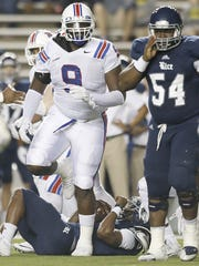 Oct 30, 2015; Houston, TX, USA; Rice Owls quarterback Driphus Jackson (6) is sacked by Louisiana Tech Bulldogs defensive tackle Vernon Butler (9) in the first quarter at Rice Stadium. Mandatory Credit: Thomas B. Shea-USA TODAY Sports