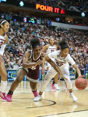 Mississippi State's Teaira McCowan (15) and South Carolina's Tyasha Harris (52) battle for a loose ball.