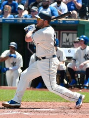 Mike Moustakas hits a two-run double in the third inning.