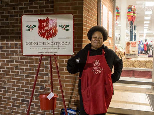 Raneka Jennings rings the Salvation Army bell Friday evening at the Old Hickory Mall.
