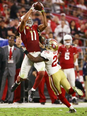 Cardinals wide receiver Larry Fitzgerald makes a catch over 49ers' Jimmie Ward in the 4th quarter on Nov. 13, 2016 in Glendale, Ariz.