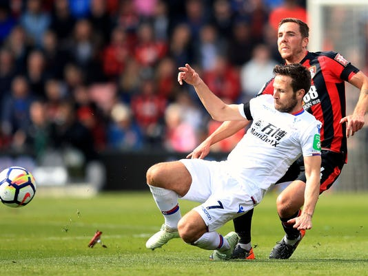 Bournemouth's Dan Gosling, right, and Crystal Palace's Yohan Cabaye in action during the English Premier League soccer match at the Vitality Stadium in Bournemouth, England, Saturday April 7, 2018. (Adam Davy/PA via AP)