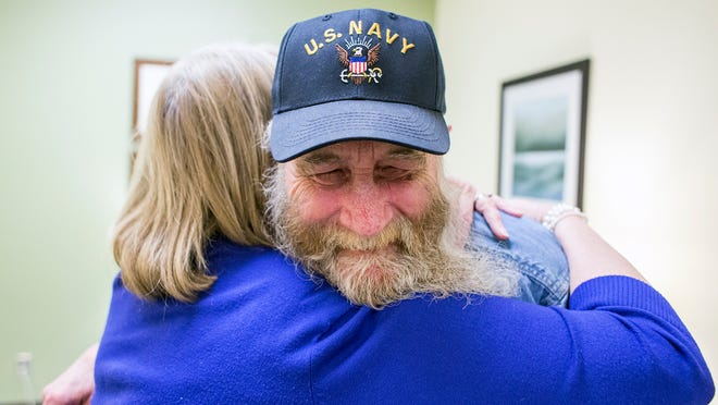 Navy veteran George Davis, 68, hugs nurse Sherry McCully-Hall after his appointment at the Charles George Veterans Affairs Medical Center integrated pain clinic on Tuesday. The VA hospital started the clinic to help its patients with managing pain with exercise, dieting and chiropractic work rather than with opiates.