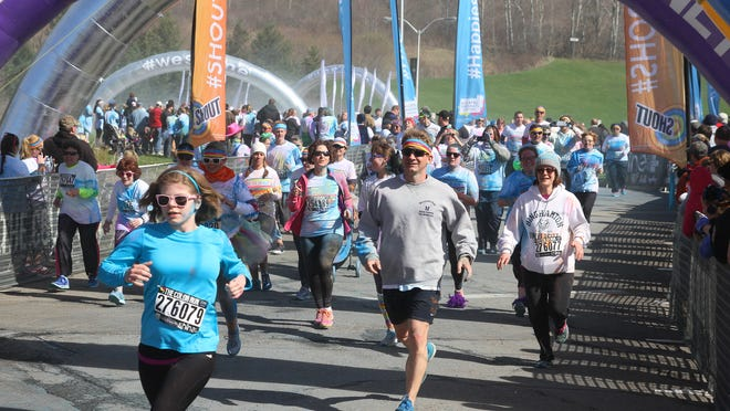Runners participate in the 2015 Color Run at SUNY Broome Community College.
