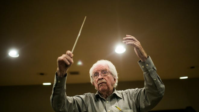 Director Jack Herriman, who has been a symphony conductor for over 20 years, directs the Chandler Symphony in a final rehearsal before Sunday's concert, April 28, 2015 in Chandler, Arizona.