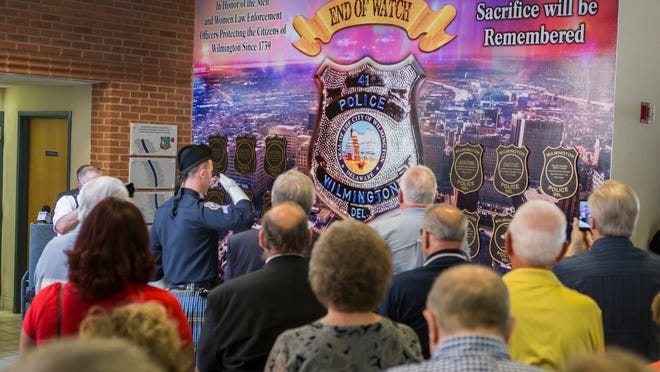 More than 100 people, including dozens of officers, gathered Friday for the dedication of a new memorial wall for fallen police officers at the Wilmington Police Department, a project of the Wilmington Association of Retired Police led by Laymen Grant, a retired patrolman.
