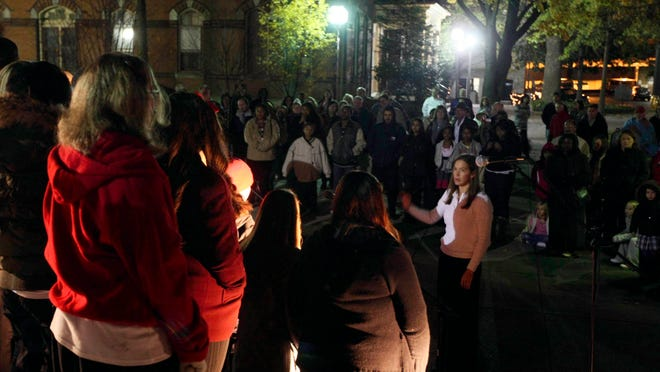 A crowd gathers to watch the Parkside High School Concert Choir perform in front of the Government building during downtown Salisbury's 3rd Friday celebration.