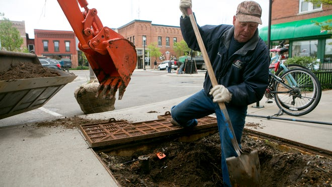 Egle Landscaping McKay Nursery Leroy Rekowski work on replacing a dead tree with a new one on Mathias Mitchell Public Square in downtown Stevens Point, Tuesday, May 12, 2015. Egle Landscaping and McKay Nursery was working under the supervision of the Stevens Point Parks Department to replace 13 trees on the square. They are also planting 27 trees to Bukolt Avenue to replace the trees that were cut down from last year's road construction.