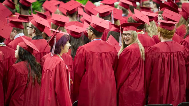 Students file in and wait for the program to begin during City High commencement at Carver-Hawkeye Arena in Iowa City on Sunday.