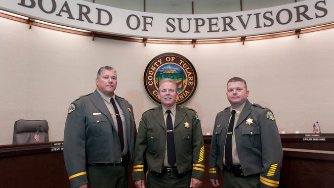 Tulare County Sheriff Mike Boudreaux promoted Joseph Campos, left, to Lieutenant, Scott Logue to Assistant Sheriff and Thomas Sigley to Captain on Tuesday, May 26, 2015.