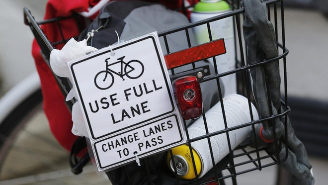 A note fastened to a bicycle basket prior to the start of Bridging Greater Lafayette: Taking the Lane Saturday, June 6, 2015, at Riehle Plaza in Lafayette. On June 8, cycling groups met with county officials to organize a meeting between West Lafayette, Lafayette and Tippecanoe County to discuss ways to improve cyclist safety on bridges over the Wabash River.