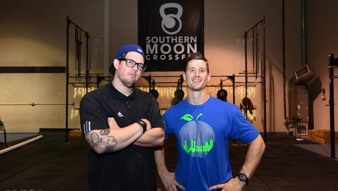 Dave Schlarb, left, and Hudson Fricke are the co-owners of Southern Moon CrossFit, a gym the two Southside Christian School graduates and former Division I athletes opened in September 2012.