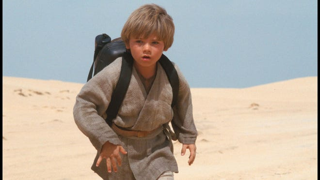 """Young Anakin Skywalker, played by Jake Lloyd, races through the sand dunes of Tatooine in a scene from """"Star Wars: Episode I The Phantom Menace."""""""