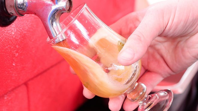 Beer is poured from a tap into a sampling glass at the Rock Bottom Brewery tent at the Fifth Annual Iowa Craft Brew Festival on June 20, 2015, at the Court Avenue Bridge in downtown Des Moines. June 2016 will bring 10 days focused on beer.