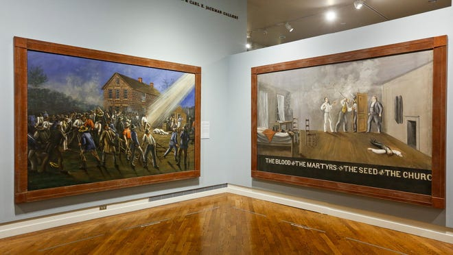 """This Friday, June 19, 2015 photo shows """"Exterior of Carthage Jail,"""" left, and """"Interior of Carthage Jail,"""" right, part of an exhibit of C. C. A. Christensen's paintings titled """"The Mormon Panorama"""" on display at the Brigham Young University Museum of Art in Provo, Utah. The new exhibit, """"Moving Pictures: C.C.A. Christensen's Mormon Panorama,"""" showcases a unique set of American folk paintings that occasionally show up in various Mormon literature. (Spenser Heaps/The Daily Herald via AP) MANDATORY CREDIT"""