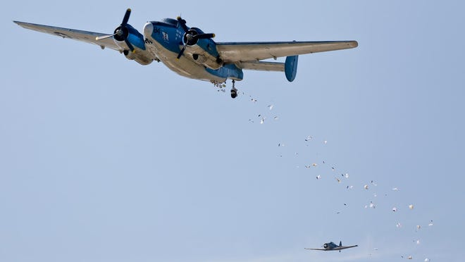 """Gail Halvorsen, known as the """"Candy Bomber,"""" drops candy bars from a plane Friday, July 3, 2015, at SCERA Park in Orem, Utah. Halvorsen, who delivered candy to children in Berlin at the end of World War II parachuted sweets down to celebrate Independence Day."""