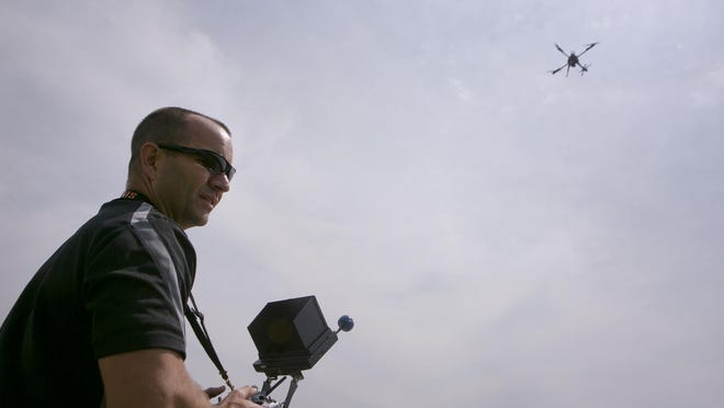 Lieutenant Scott Saeger demonstrate how to fly the drone the Wood County Sheriff's department purchased behind the South Wood County Recreation Center in Wisconsin Rapids.