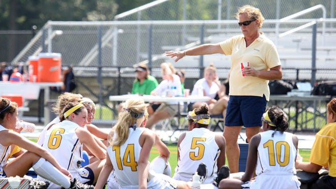 Pocomoke High field hockey head coach Susan Pusey talks to the team during half time during the game against Delmar Saturday.