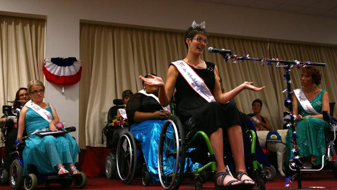 The reigning Ms. Wheelchair America, Samantha Schroth, gives her final speech before the new winner is crowned at the Marriott in downtown Des Moines on Saturday.
