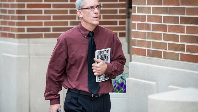 In this file photo, Matthew Puterbaugh walks to the York County Judicial Center for two formal arraignments. Puterbaugh, 51, of Dover Township, is serving 15 years in federal prison for production of child pornography.