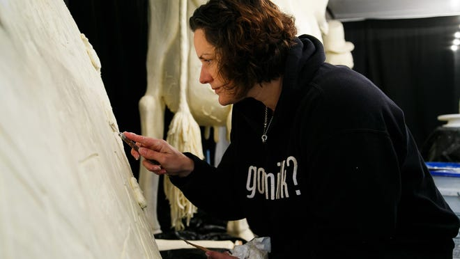 """The fifth butter sculptor for the Iowa State Fair, Sarah Pratt of West Des Moines, apprenticed with Norma """"Duffy"""" Lyon for 15 years until she took over in 2006. Here is Pratt sculpting her 10th cow in 2015."""
