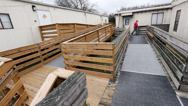 A December 2014 file photo shows a maze of walkways and ramps that connects some of the 15 portable classrooms in use at John Colemon Elementary in Smyrna.