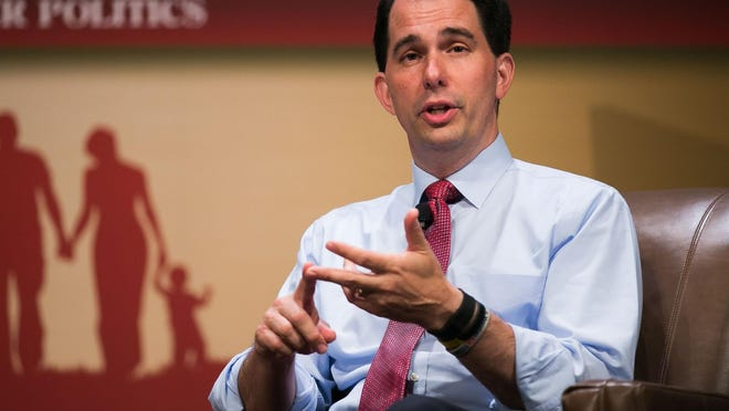 Scott Walker said his God guides all his decisions, including his reaction to protests over collective bargaining rights in Wisconsin. Sen. Walker speaks with Frank Luntz during the Family Leadership Summit in Ames on July 18.
