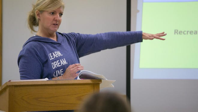 Molly Bailey of Fairport, executive director of Girls on the Run of Greater Rochester, speaks at a training session for coaches in the Girls on the Run program in Fairport last month. Girls on the Run started in 1996, and matches volunteer coaches with girls between third and eighth grade to teach life skills through running.