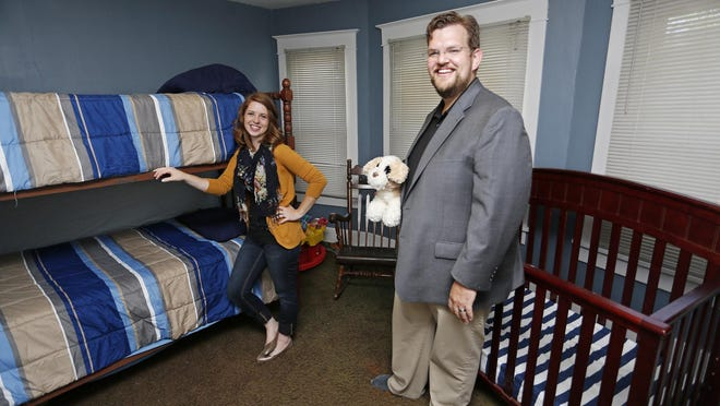 Foster parents Justin and Lydia Brownfield in the nursery Monday, August 10, 2015, of their Lafayette home. There is a shortage of foster parents in Tippecanoe County.