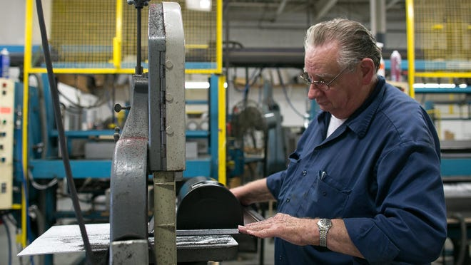 Ron Krueger of Rochester works at Faro Industries in Rochester on Wednesday, October 7, 2015.