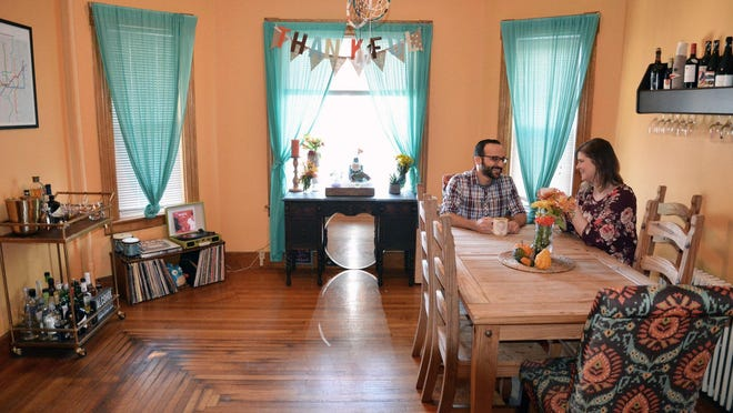 Katie O'Connor and Marcus Ohanesian pose in their apartment that they list on Airbnb in Worcester, Mass. Ohanesian and O'Connor list their apartment on Airbnb.