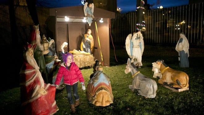 Madyson Oleson, 5, of Rome wanders through a Nativity scene in Thompson Park before the Nekoosa Area Hometown Christmas parade, Saturday, Dec. 5, 2015.
