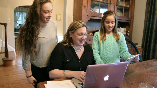 """Just Add Magic"" author Cindy Callaghan with daughters Ellie (left) and Happy in 2014 shortly after Amazon announced a series based on her work."