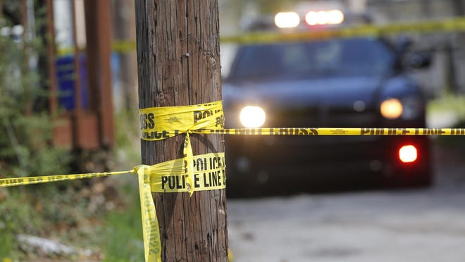 Police respond after a man was shot April 21 at Ninth and Salem streets in Lafayette.