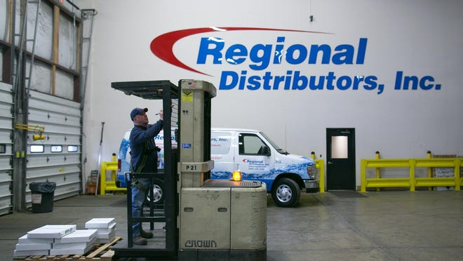 Keith Fletcher of Ontario works at Regional Distributors in Rochester on Thursday, February 4, 2016. The company distributes various products including commercial cleaning supplies.