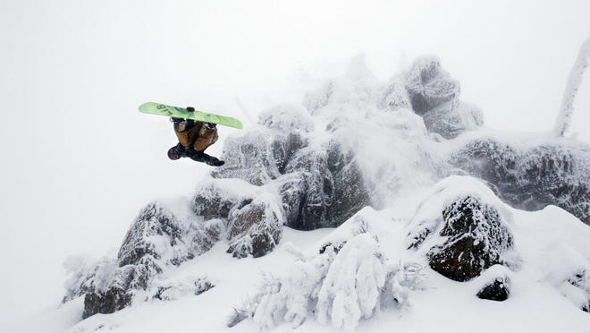 """Jason Robinson flips off the """"Buckle Your Boot"""" feature at Whitefish Mountain Resort in Whitefish on Jan. 20."""