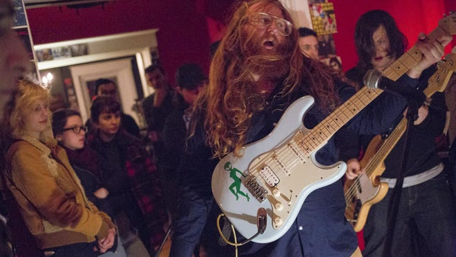Cadillac Young of the Foxery, performs, Saturday, Jan. 16, 2015, at Modern Cult Records in Louisville, Ky.